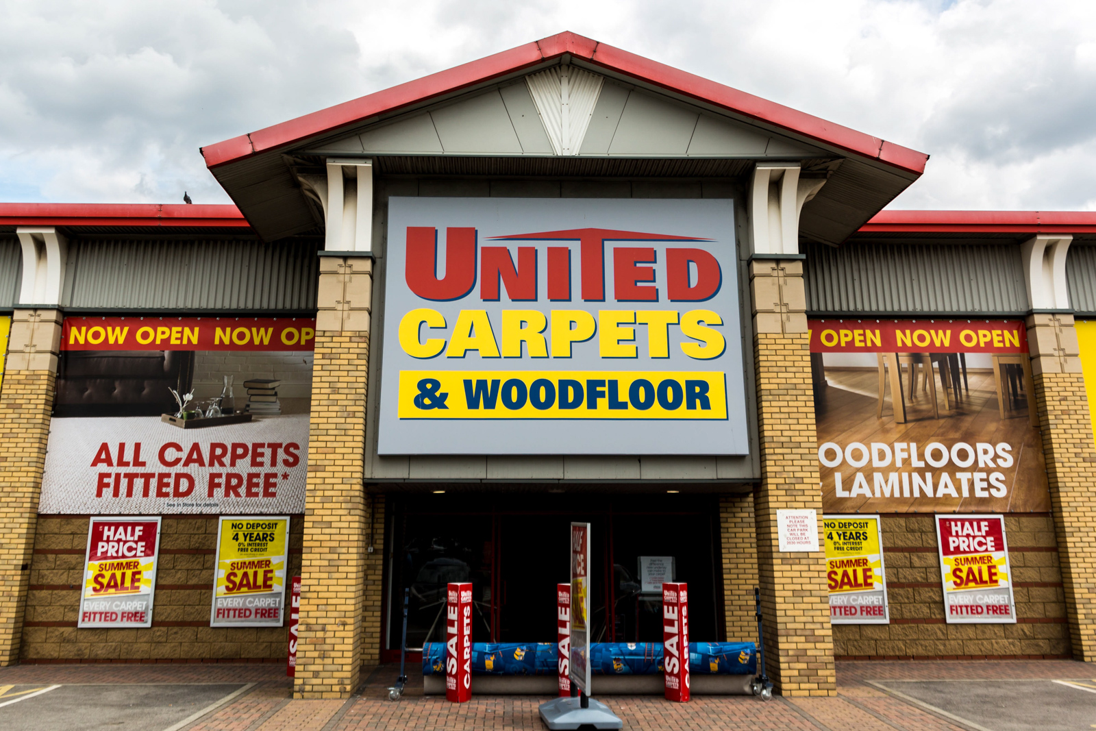 signage - united carpets